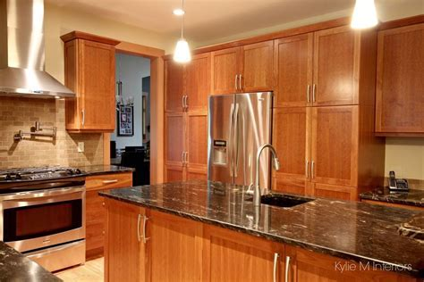 Natural cherry cabinets in kitchen, island, pantry wall