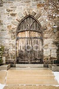 old wooden double doors to a stone church stock photos With church double doors
