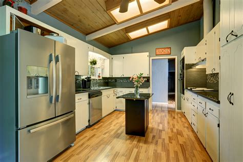 pros and cons of painted kitchen cabinets the pros cons of painting kitchen cabinets big brush 9739