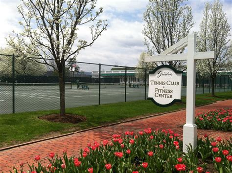 outdoor tennis courts surrounded  beautiful flowers  thegreenbrier  lovely view