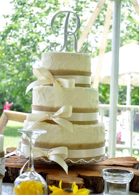 rustic style wedding cake  burlap  ivory ribbon