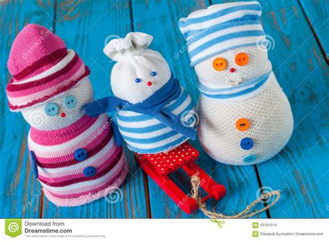 handmade snowman family wearing scarf  knitted stock
