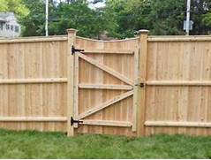 Fence Beautiful Privacy Fence Gate Ideas Get The Right Designs And Wood Fences Fence Design Uses Stone Columns And Wooden Fence Panels With A Wooden Wood Fence Gate Designs Architectural Design