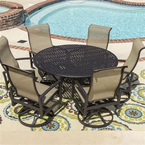 round table patio set outdoor acadia 7 piece sling patio dining set with swivel rockers
