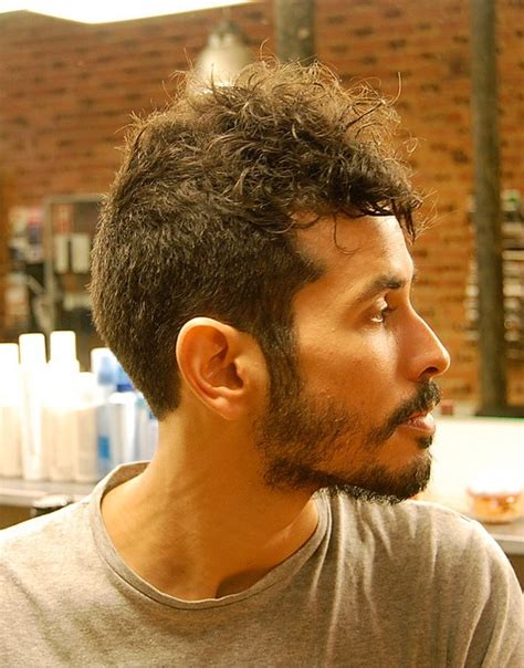 short curly haircut for men long buzz cut with hawk top