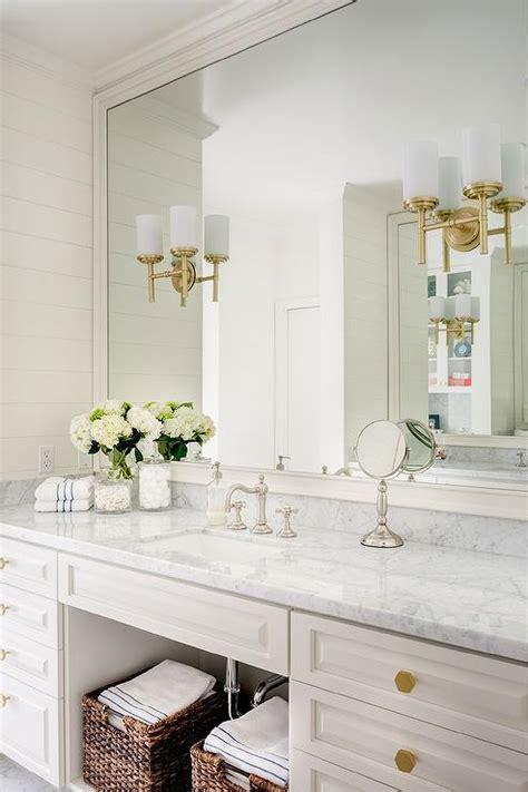 white bathroom vanity  gold hexagon knobs
