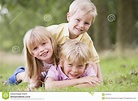 Three Young Children Playing Outdoors Smiling Stock Image ...