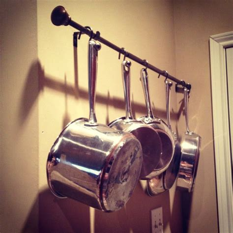 hanging pots and pans on wall diy pot and pan rack for wall hang a curtain rod with