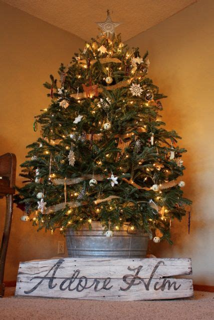 christmas tree in galvanized tub come let us adore him the sign and the tree in a galvanized wash tub insert heart felt sigh