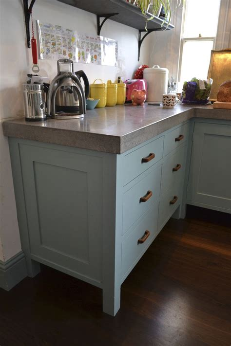 Ideas For Kitchens With White Cabinets - hand painted bespoke kitchen with vintage wooden handles and polished concrete worktops