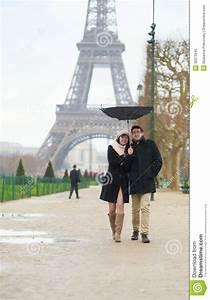 Couple Walking Under The Rain With Broken Umbrella Royalty ...