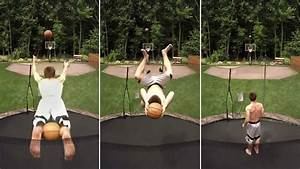 Man sinks two basketballs from on trampoline in trick shot ...