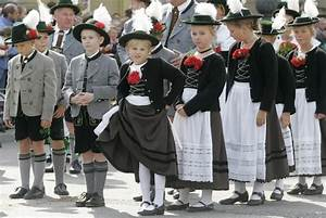 Children in traditional Bavarian clothes wait during the ...