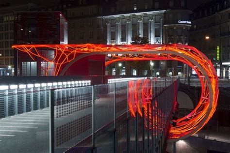 led lights in switzerland flux cocoon made from 3 600 led lights wraps around a bridge in lausanne switzerland
