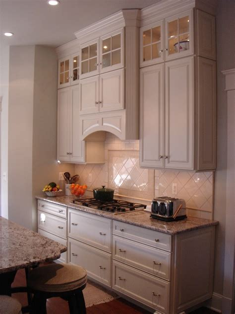 range hood cabinet Kitchen Traditional with black counters