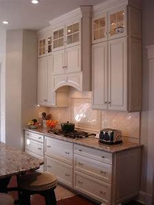 Range hood cabinet kitchen traditional with black counters for Kitchen range hood cabinet