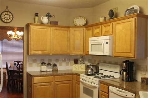 Decorating Ideas For Kitchen Cabinet Tops by Decor Rearranging The Tops Of My Kitchen Cabinets