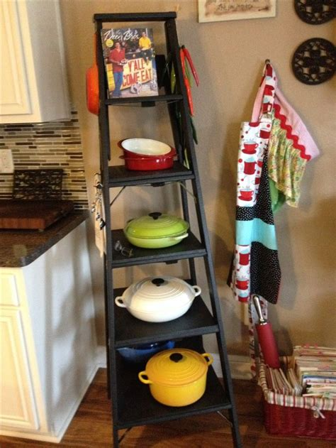 le creuset pans displayed  repurposed  great storage solution easy access home
