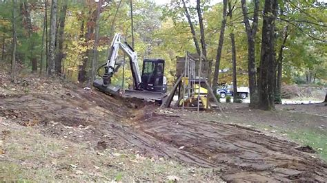 bobcat  grading swale youtube