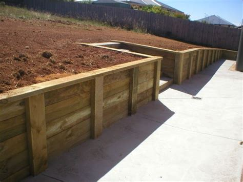 wood post retaining wall pin by heidi bell vicneire on landscaping ideas pinterest