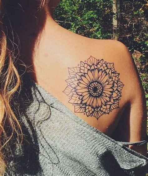 boujee sunflower tattoo ideas shoulder