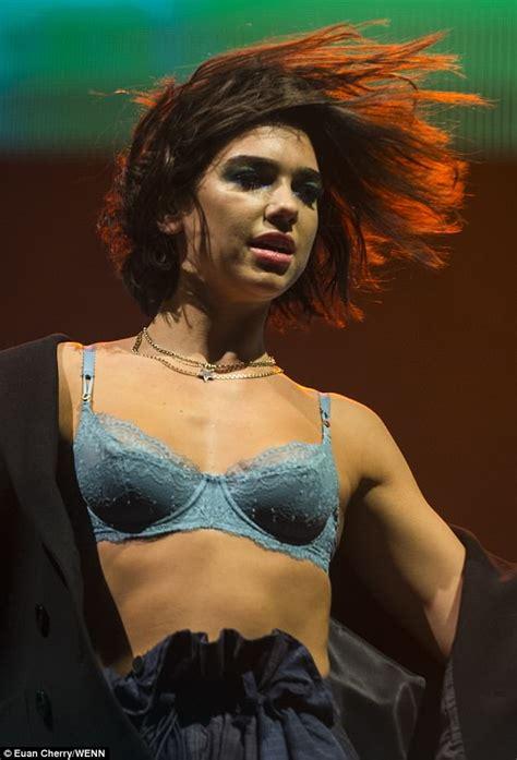 Dua Lipa shows off her toned figure in blue lace bra at ...