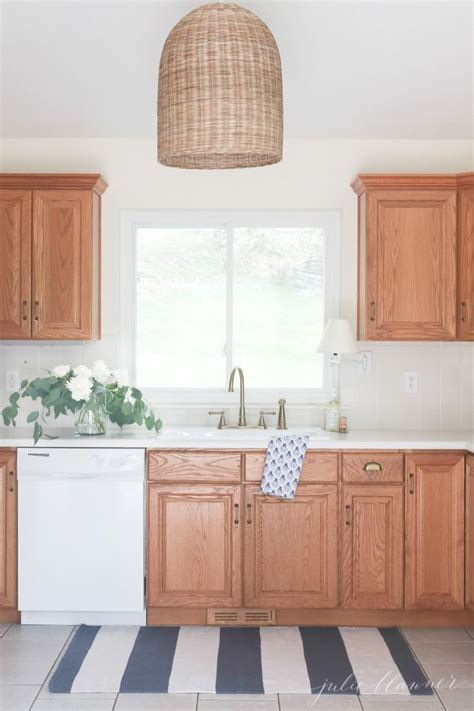 How To Paint Cupboards by How To Update A 90 S Kitchen Without Painting The Cabinets