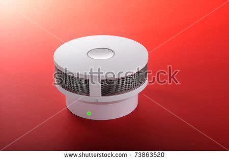 green light on smoke detector alarm with green light signal smoke detector stock
