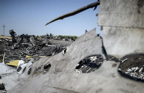 Malaysia airlines flight 17 (mh17) was a scheduled passenger flight from amsterdam to kuala lumpur that was shot down on 17 july 2014 while flying over eastern ukraine. First MH17 crash report 'in weeks': Dutch investigators