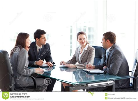13612 business meeting table businessmen and businesswomen talking at a table stock