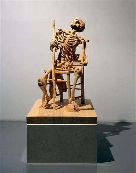 carved wood skeletons insanely detailed woodwork