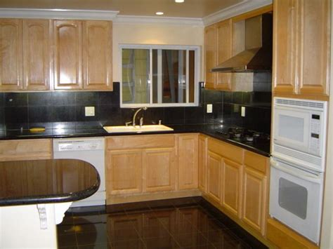 kitchen cabinets with black appliances black counter looks but not with white appliances Maple