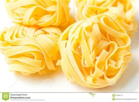 Dry Pasta Tagliatelle On Tablecloth Stock Photo   Image