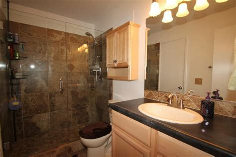 This photo of the fully remodeled upstairs full bathroom