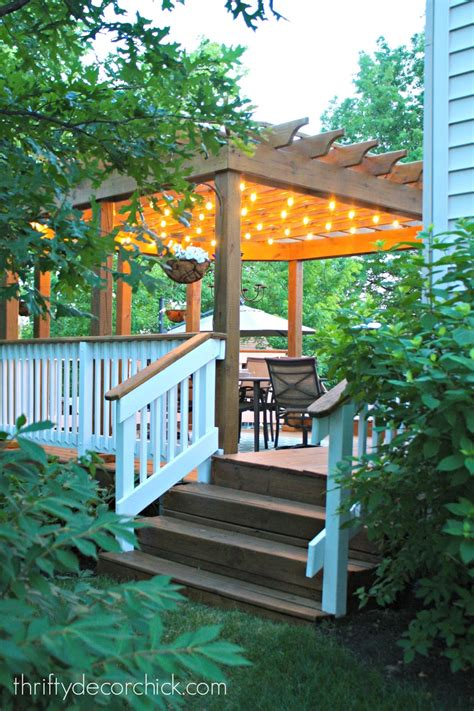 how to hang outdoor string lights from thrifty decor