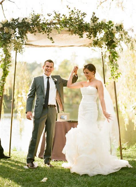 outdoor garden wedding ceremony groom altar flowers