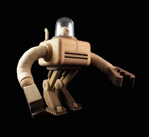 wooden robot figurines fubiz media