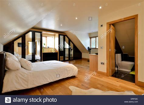 Modern Master Bedroom With Ensuite Bathroom Stock Photo