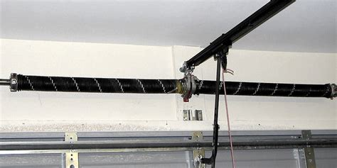 garage door torsion grove roller doors broken torsion springs