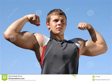Flexing Biceps stock photo. Image of attractive, look ...