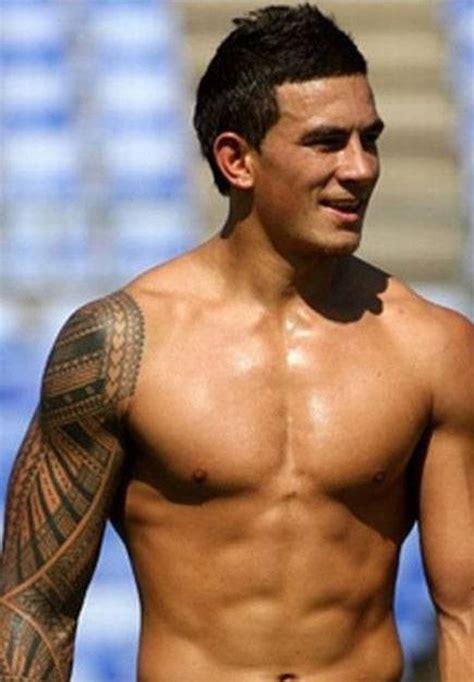 strong mens geometric shoulder  tattoo