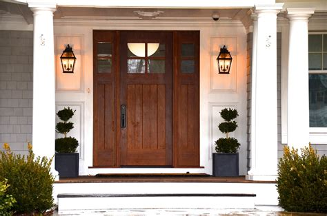 front entrance outdoor lighting black metal wall sconces lantern style guarding the front