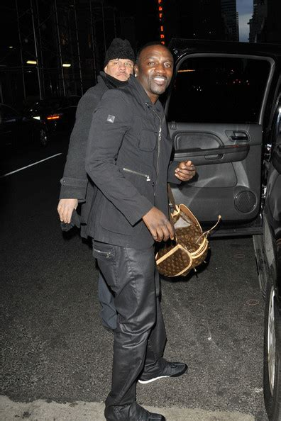 akon wears louis vuitton bosphore monogram canvas backpack