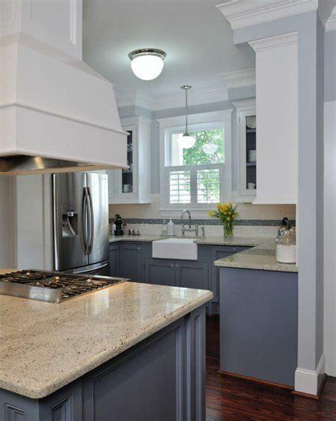 White upper cabinets, dark grey lower cabinets, grey/blue
