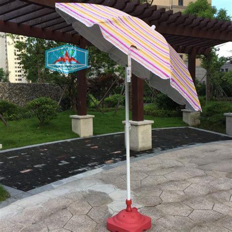 orange color striped umbrella steering