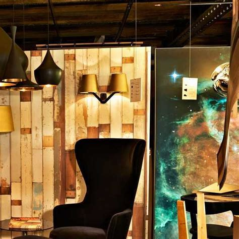 base wall light is a designer wall light by tom dixon
