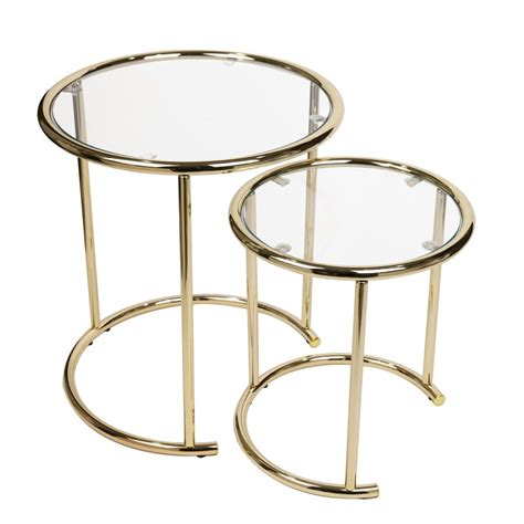 A round gold coffee table is never out of fashion. DANYA B Gold Nested Round End Tables with Clear Glass (Set of 2)-HA15904CL - The Home Depot