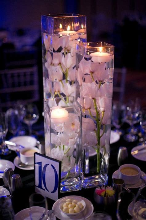 Wedding Vase Rentals - rent three different size vases and fill with silk orchids