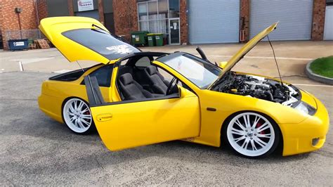 yellow nissan 300zx with 20inch white rims lowered ...