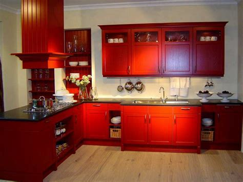 Red Color L Wooden Cabinet With Black Marble Countertop